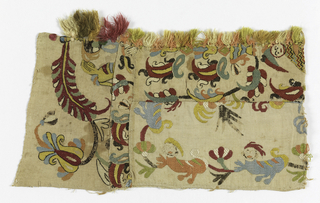 Fragment showing fantastic animals, flowers and a human figure in multicolored silk on a natural ground.