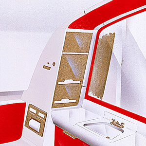 Vertical rectangle. Design for airplane lavatory with black floor, white walls and bathroom fixtures and red accents on toilet, cabinet, and mirror paneling.  Gold faucet fixture and paneling on toilet paper and paper towel storage.