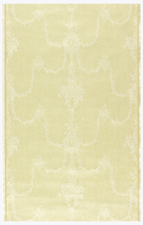 White delicate arabesque designs embossed on a tan ground.