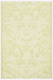 Dense Rococo scrollwork and flowers of white with a yellow background embossed on a white ground.