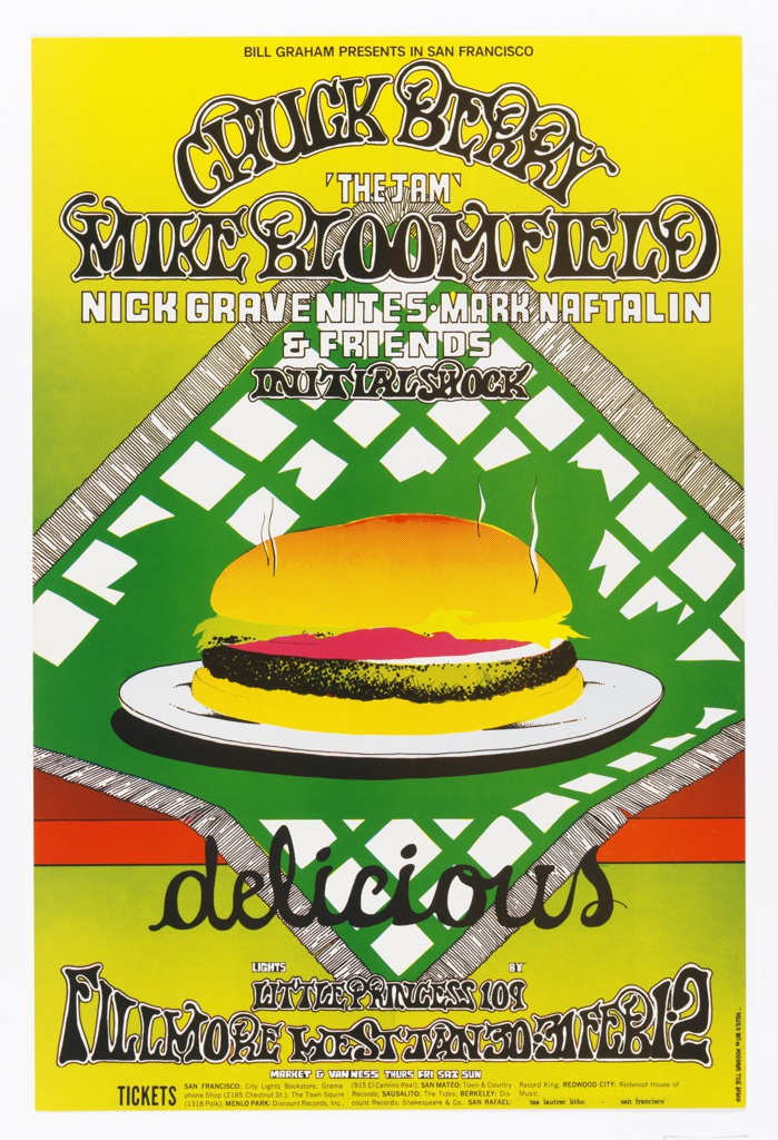 Poster featuring a steaming hamburger on a green and white napkin on a red table on a yellow background. Text in black and white: BILL GRAHAM PRESENTS IN SAN FRANCISCO / CHUCK BERRY / 'THE I AM' / MIKE BLOOMFIELD…[ticket information below].