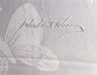 "Damask tablecloth, belonging to the Andrew Carnegie household, with embroidered signatures of many guests scattered around the cloth. The years 1935, 1942 and 1948 are also recorded. ""Centenary Commemoration"" appears in letters larger than the guest signatures."