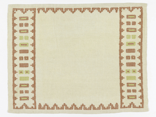 Rectangular mat with wide end borders in a geometrical design of pale green and salmon pink. Narrow side borders are in same salmon pink.