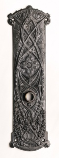 Upright, roughly rectangular form with curved edges at top and bottom; cast decoration of stylized vegetal motifs, the word GUARANTY (for the Guaranty Building, Buffalo, NY (1896, Adler and Sullivan, architects) in oval worked into decoration at top; circular hole for doorknob slightly above center; a small screw hole near each corner.