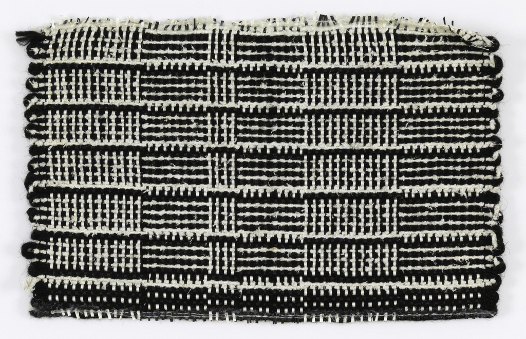"""Warp: black and white rovana, Weft: ivory asbestos and black synthetic (?) Plain weave: changes in alternation of warp and weft colors for rectangles, sometimes called """"log cabin""""."""