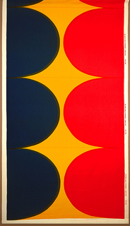 Large-scale graphic pattern of half oval shapes intruding from each edge to nearly meet in the center; in blue, yellow and red.