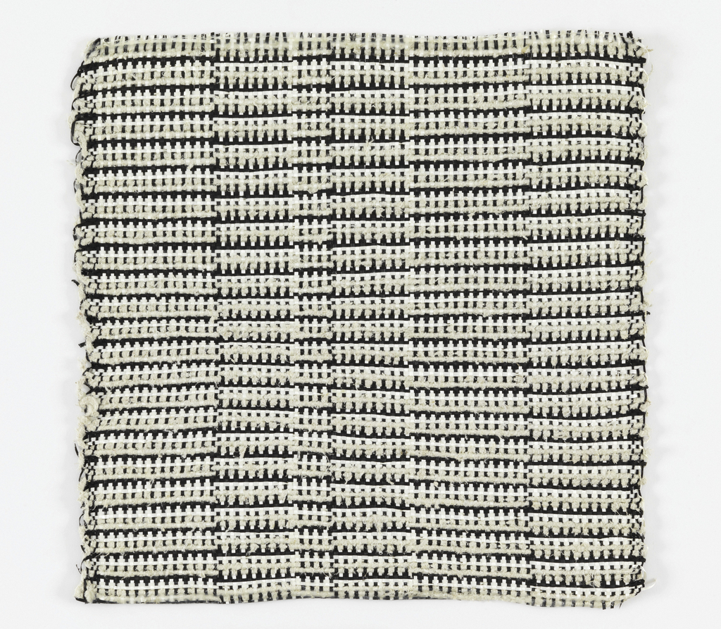 Warp: black and white rovana, Weft: black rovana and ivory asbestos. Plain weave with changes in the alternation of warp colors.
