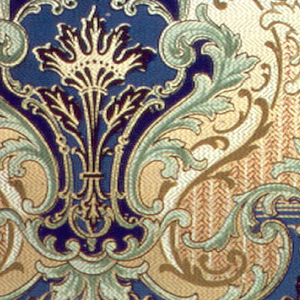 Alternating medallions framed by acanthus leafs. A small fleur-de-lis inspired design sits between each medallion. The center of the medallions are shades of blue while the acanthus leafs and fleur de lys shapes are shades of green. The fleur de lys are on a tan background. The overall background is a light green.