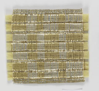 Warp: gold and silver lurex combined with fine meteal wrapped yarn (fine linen at each edge) Weft: gold lurex combined with fine metal wrapped yarn