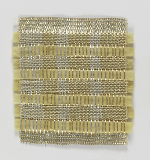 Warp: gold and silver lurex combined with fine metal wrapped yarn (fine linen at each edge) Weft: natural fiber, insulating glass