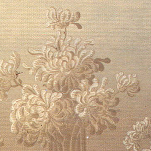 Floral bouquets in the anthemion design shape, alternating between large and small bouquets.  All bouquets are connected by continuing bands. Whole design on a screened field the colors of which progressively change to their negative colors. Printed in various shades of brown from mud brown to chocolate brown to a light, almost peachy-tan brown.
