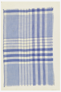 Blue and white plaid woven sample stitched onto cardboard.