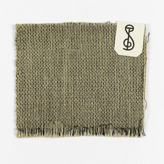 Black warp and white weft woven fabric with cellophane plain weave face on the front and burlap type plain weave face on the back.