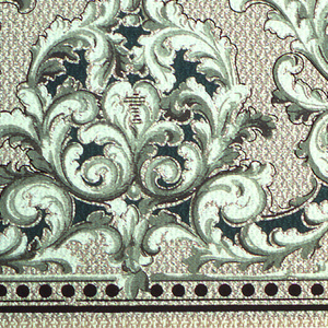 Anthemion of alternating large and small acanthus.  Beading and stripes at bottom. Textile simulated background. Printed in green, white, and tan.