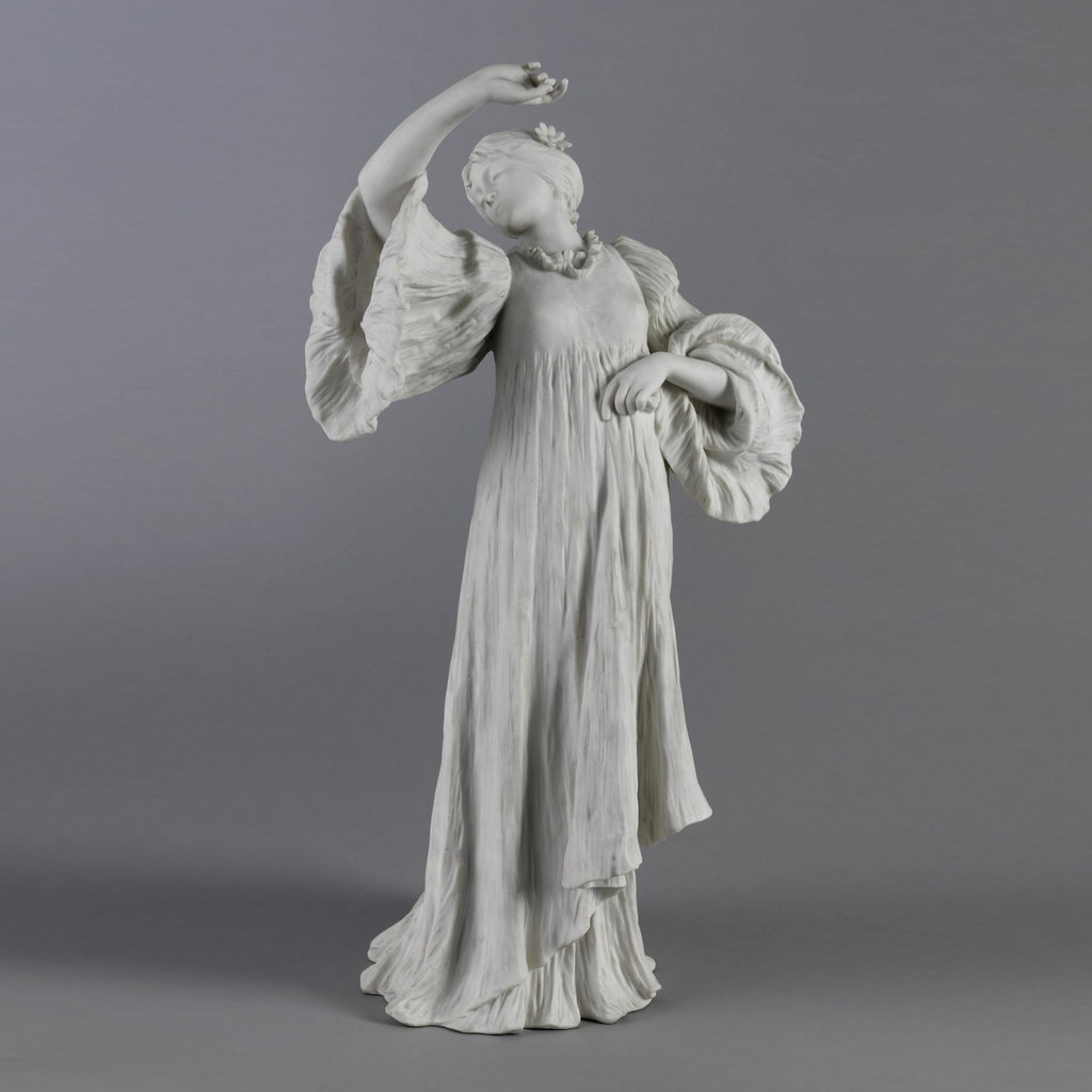 Figure in long flowing gown, full sleeves. Head thrown back, turned to right. Right arm upraised, flexed, palm turned outward. Left hand gathers gown at waist. Sandaled left foot appears at back.