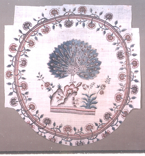Circular motif from a cover or a palampore. Peacock on a mound.