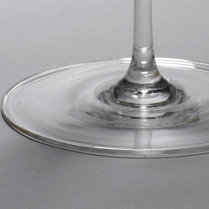 Clear, thin-walled glass form: slightly ovoid bowl with everted rim surmounting simple slender stem with slightly domed foot.