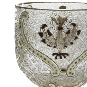 Translucent stemmed glass rising from a circular foot, mold-blown, acid-etched, painted and gilded, enameled with various cartouches containing coats of arms and armorial devices of Lorraine and Russia, including Crosses of Lorraine.