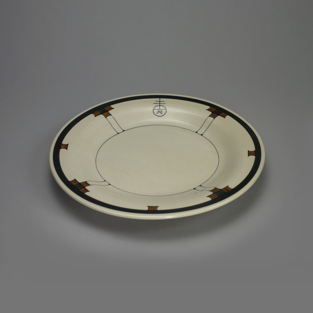 Cream-colored ground with a decorative pattern of a dark blue circle on the edge from which are suspended four designs connected by fine blue lines to a fine blue inner circle, alternating with three brown brown squares, with the Roycroft logo in one panel.