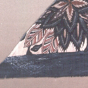 Portion of one end of a fabric showing blue heading and exotic flowers.
