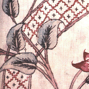 Small fragment showing part of a cornucopia-like shape and floral vines.