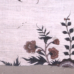 Two fragments which show the mirror image of a flowering tree motif.