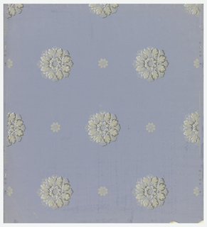 A full width, giving two repeats of drop-repeating design composed of alternating large, shaded foliate rosettes and small, flat-color rosettes. Greys and white on blue ground.