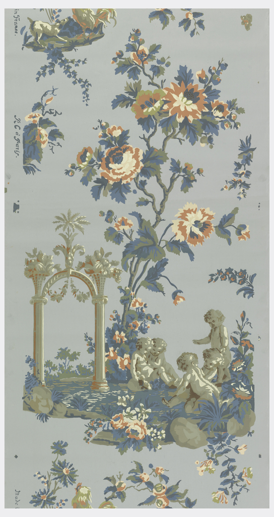 Scenic vignette with five putti or small boys, next to a large arched column. Large-scale flowering vine with roses and carnations rises up from center of vignette. A rooster is perched on top. Printed in pink, white, blue, green and taupe on light blue ground.