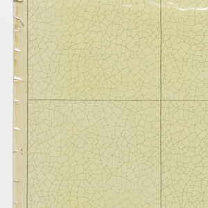 A bathroom-type (sanitary) paper divided into squares, simulating tile, three squares to a width. An over-all, jagged, chipped design is outlined in green on a very light-green ground. The squares are outlined thinly in darker green.