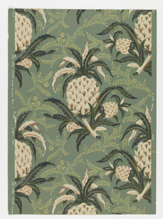 Single, large drop-repeating motif of pineapple, in pinks with green leaves. Every other row the pineapples reverse direction. Leafy vines embellish the intervening spaces. Ground has irregularly spaced orange pin dots.