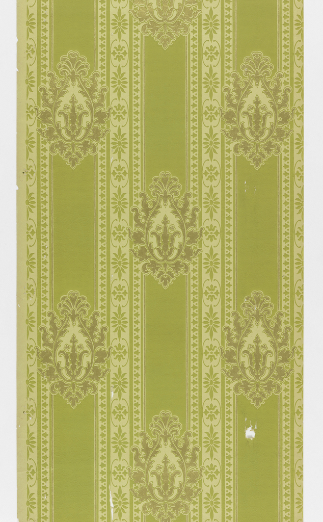 Medallion stripe design; metallic gold foliate medallions on green bands alternate with stylized floral bands. Printed in metallic gold and yellow-green on an embossed mica ground.
