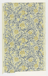 Swirling blue foliage with blossoms and berries. Printed in gold and creamy yellow on off-white ground.