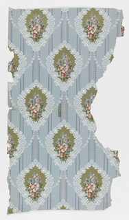 On light blue ground with vertical blue-edged mica stripes, alternating lozenge-shaped medallions with blue & white floral edge; metallic gold center field with bouquet of pink, red and blue flowers and green leaves; medallions are linked by vertical mica ribbons at the top and bottom, and small white daisy chains forming a trellis pattern.