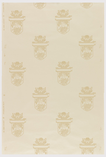 Large crest with mask on top, printed in off-white on irridescent ground.