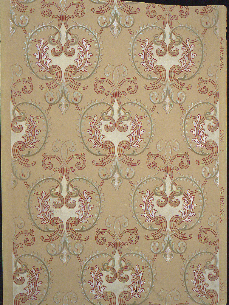 """Repeating motif of scrolling medallion, printed in green and pink mica, burgundy and green on a tan ground. Printed in selvedge: """"2330 5""""."""
