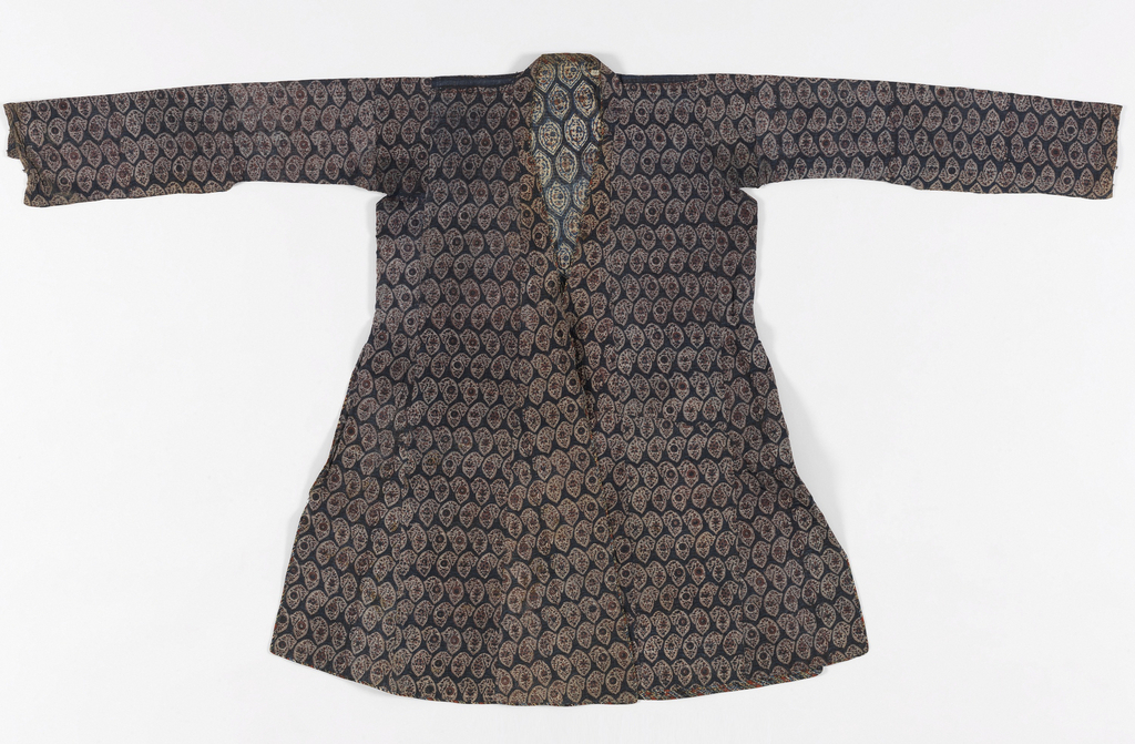 Coat of printed cotton, quilted. Combination of block and resist printing showing allover pattern of blue and brown floral buta on white ground.