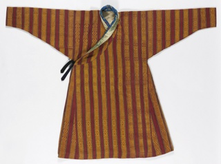 Woven cotton coat with design of thick vertical stripes in brick red with smaller stripes in mustard, blue and green. Brocaded vertical bands of geometric motifs in mustard. Collar made of two pieces of silk: blue with flowers and gold with dragons. Lined with heavy white twill weave fabric. Black tie at side.Short tapes at underarm seams. Robe is worn looped up at waist and gathered tightly at back, which produces a pouch-like area, at front.