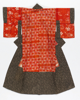 Woman's under-kimono of lighweight silk with 4 clamped resist patterns: butterfly among leaves, in red on a white ground; 6-pointed star grid, in 2 shades of red and white; blossoms and water, in white on a red ground; and chrysanthemum and butterfly in red on a white ground. Lined with red-orange silk with gray silk crepe inside bottom and halfway up the opening. Edges faced with stencil-patterned silk. Hem and sleeves padded with unspun silk.  The four red fabrics are pattern-dyed using teh itajime process, in which a folded fabric is pressed between boards, the two faces of which are carved with the same pattern. Holes in the board allow for the passage of dye.