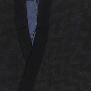 Man's coat made from two layers of cotton fabric, dyed dark indigo blue on the outside and lighter blue on the inside, quilted in running stitches using a medium blue cotton thread. The quilting pattern on the sleeve is a swastika fret, and on the body a diagonal herringbone.