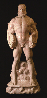 "Figure of Neptune standing, holding writhing fish in each hand, base with rounded bottom of foaming waves, glaze white with pink ""flushing."""