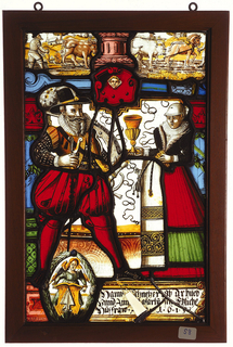 Rectangular stained glass panel depicting a well-dressed couple (marriage portrait?); he holds a two-pronged scepter and the woman holds a gold goblet in one hand. Below them, a wreathed oval showing a winged angel behind a gold pulpit with a white arrowhead pointing up. Above the couple, red escutcheon with angel head. Above this, landscape scene of horses and oxen pulling as a man plows. Text below.