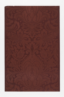 Simulates damask. Heavy foliate forms in bisymmetrical arrangement. Printed in red on darker red ground.