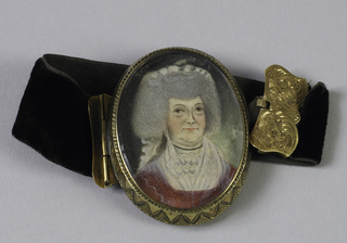 Oval portrait miniature of a woman wearing red dress, ca. 1790, behind glass and encased in gold frame; set into a black velvet bracelet with chased gold clasps, ca. 1830.