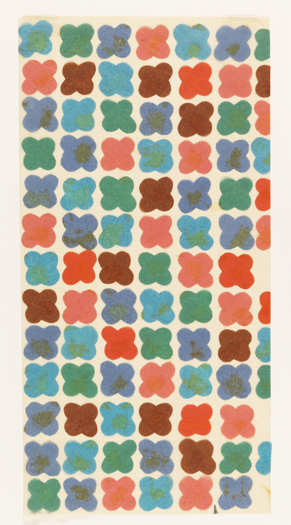 Six vertical rows of small, thick, four petaled flower motifs made from pink, light blue, blue, green, brown and red colored tissue paper. These flower motifs differ slightly from other designs in the series.
