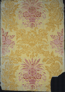 Diaper pattern composed of acanthus leaves. A basket with floral bouquet is contained within each cartouche. Printed in ocher, red and pink on yellow ground.