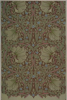 Symmetrical design with scrolling foliage and vertical repeat. Printed in green on darker green ground.