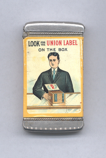 "Rectangular, rounded corners, featuring man with black hair in black suit, white shirt, blue tie; he stands behind glass counter, holding with right hand a large box of cigars; inscription above reads ""Look for the Union Label on the Box."" Right side panel inscribed ""Compliments of Cigarmakers Union #97, Boston, Mass."" in black on orange ground. Left side panel inscribed ""Not made by the Trust"" in black and red on orange ground. Reverse inscription ""Honesty, Skill & Cleanliness, Your Protection, Smoke Union Made Cigars,"" in black and red on orange ground flanks green facimili of ""Union-made Cigars Local Stamp."" Lid hinged on side. Striker on bottom."