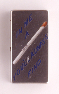 """Rectangular, the front inscribed on the diagonal with the word/picture rebus """"In Me A [Match] You'll Always Find,"""" the text in blue enamel, an image of the match featured in white with red tip. Reverse undecorated. Lid hinged on left. Striker on bottom."""
