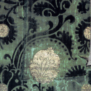 Swinging branches with pomegranite, fruit and blossoms in green and metallic.