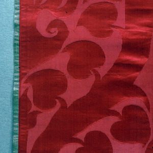 Ogival bands with heart-shaped leaves in red.